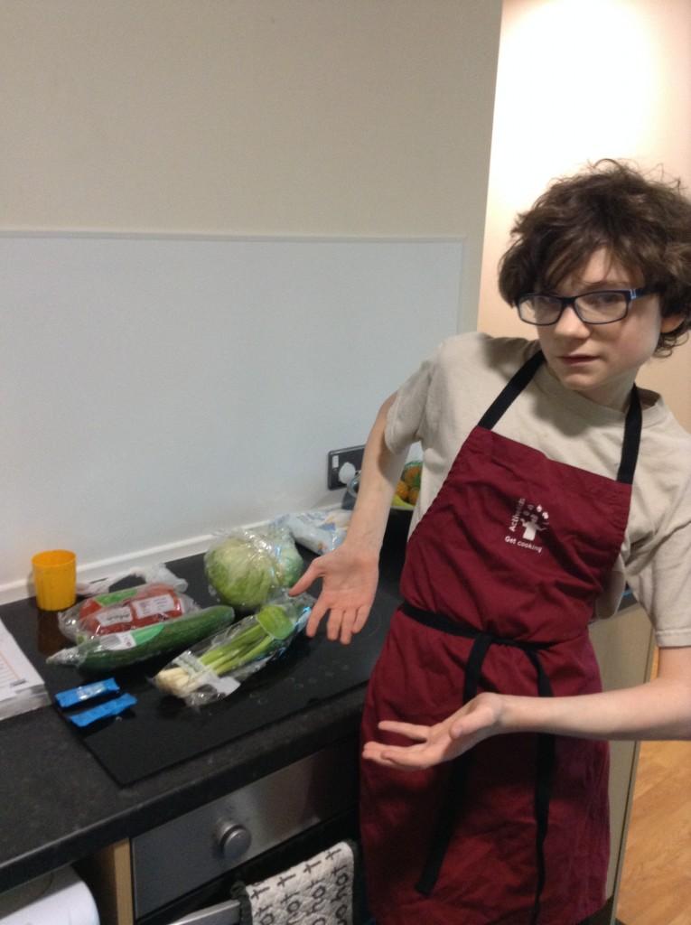 George preparing his salad